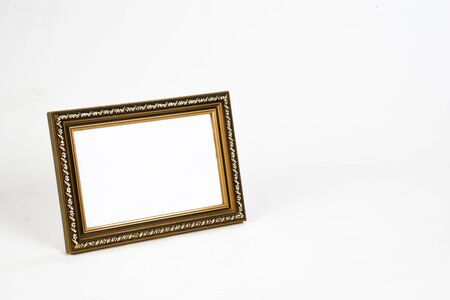 carved wooden picture frame the white background.