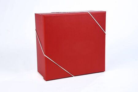 beautiful red gift box with closed lid with side view and space for text on white background Reklamní fotografie