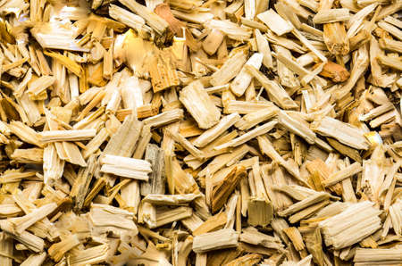 residue: sawn wood cut piled perfectly as backround Stock Photo