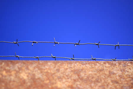 keepout: Barbed wire on rusty gates