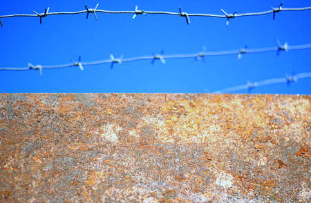 The barbed wire over the wall Stock Photo