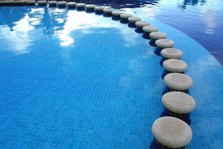 limpid:      Seats inside of the swimming pool                           Stock Photo
