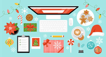 Christmas and New Year holiday celebration at home concept with computer and gift boxes on table.