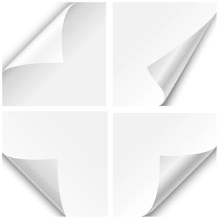 bent: Paper Corner Folds - Set of four paper corner folds isolated on white background