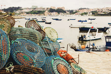 crab pots: Fishing traps and anchored boats in Porto, Portugal