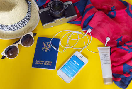KYIV, UKRAINE - MAY 20, 2016: Different objects for traveling with Instagram on yellow background Editorial