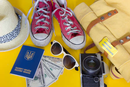 Different objects for traveling on yellow background Stock Photo