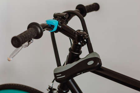 Bicycle and U shaped lock on handlebars Stock Photo