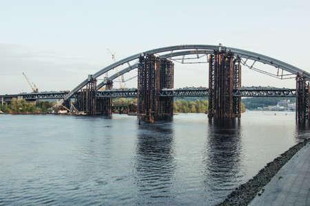 Kyiv, Ukraine - May 02,2017: View of the Podilsko-Voskresenskyi bridge in Kyiv which is under