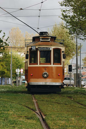 Old tram over dramatic sky in Porto, Portugal