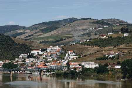 View from Pinhao village in Portugal to Douro valley and river with boat