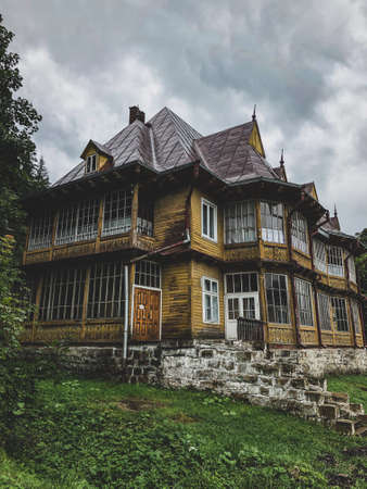 Picturesque landscape with old wooden house in the Carpathians
