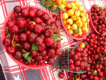 lots of different cherries in baskets