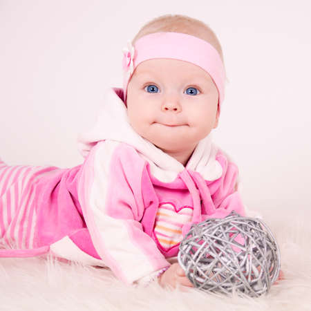 smiling baby in pink photo