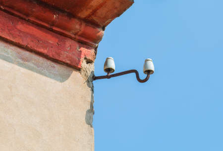 insulators: Old porcelain insulators on the wall obsolete technology