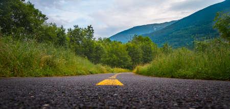 aim: Paved cycle lane with yellow path - far destination