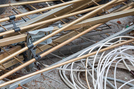 cable tangle: Scrap cable and metal in a waste landfill background