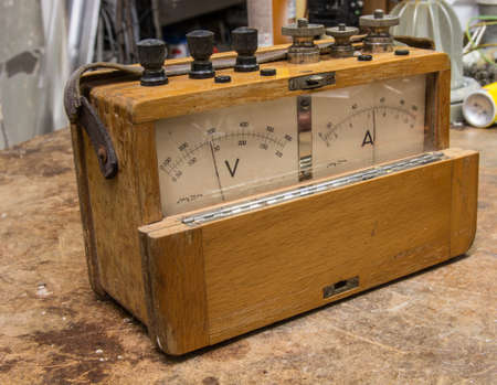 electric meter: Vintage analog wooden electric meter on the old table test