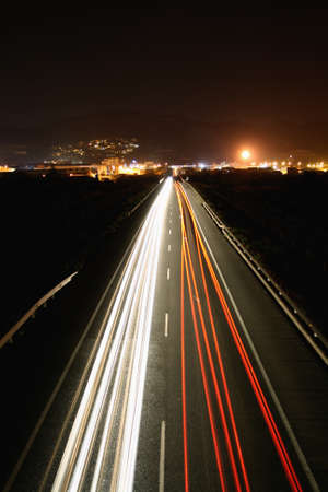Long exposure of traffic with red and white trails of light. Stock Photo