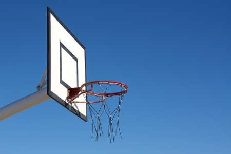 basketball hoop on blue sky