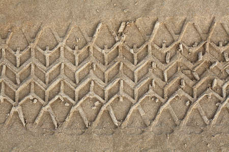 Tyre track on sand photo