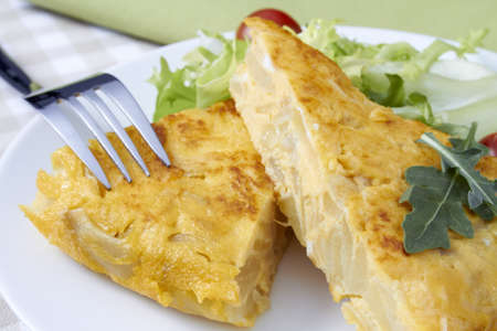 Spanish omelette served with salad