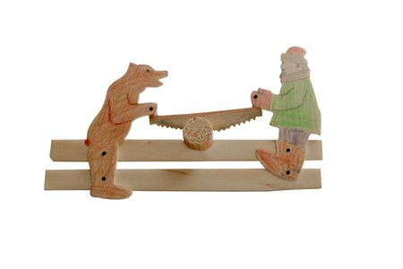 playthings: childrens toy from plywood of People and a bear saw the yard