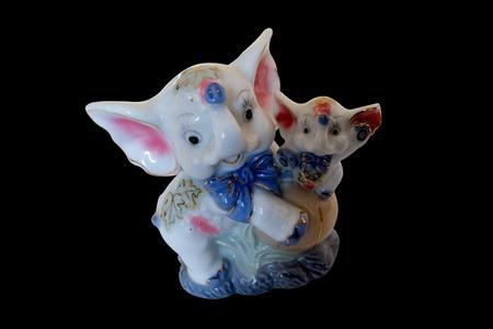 sequester: ceramic figurine of an elephant and a baby elephant