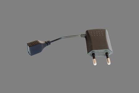 transducer: AC adapter with USB. Isolate on gray background