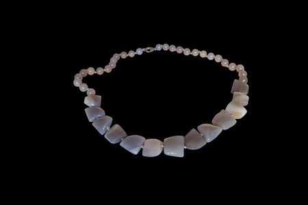 concretion: Beads from natural Brazilian agate on a white background