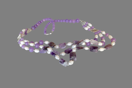 concretion: necklace of amethyst and pearls.  Isolate on gray background Stock Photo