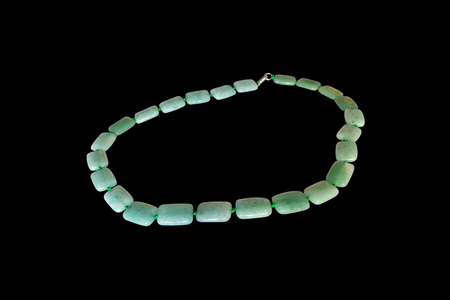 nephritis: green nephrite necklace.  Isolate on black background