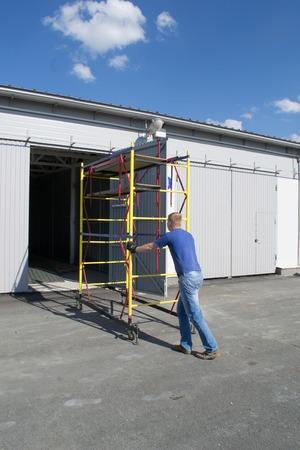 installer: The installer moves the scaffolding at a different location