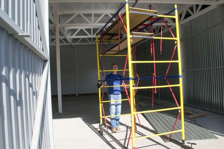 erector: The installer moves the scaffolding at a different location