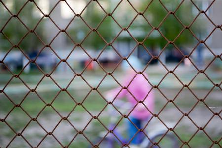 Protective grid around the playground
