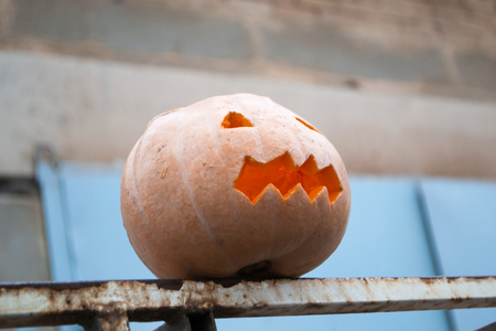 Preparing for Halloween. Pumpkin on a fence.