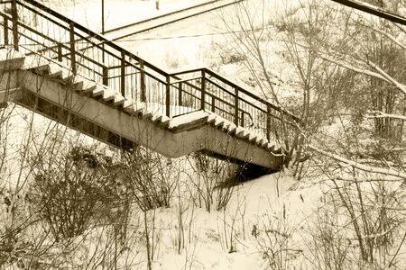 Pedestrian bridge over the railway. Stairs. Black and white