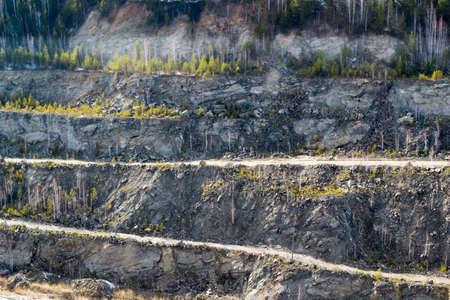 Graphite quarry. Open pit mining of graphite