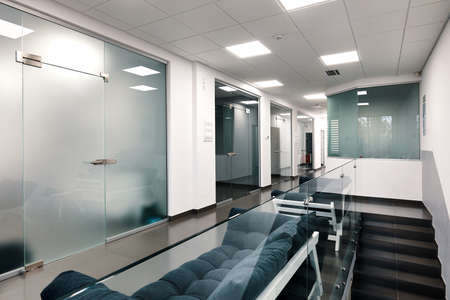 Bright large modern office interior with glass doors