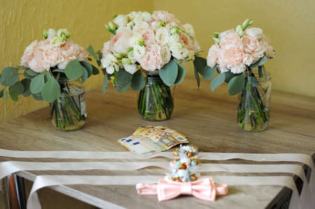 Mens accessories for groom, money, flawers and bow tie on the table Stock Photo