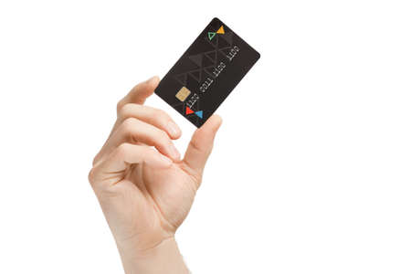 Close up of a hand holding a black credit card on a white background. Focus on the card.