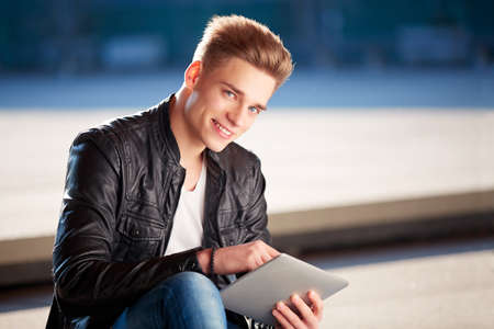 cool guy: Young student with tablet Stock Photo
