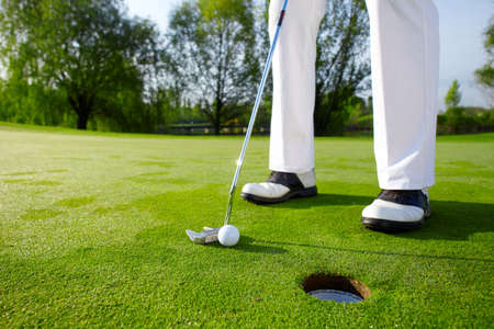 training course: Golfer on green is putting Stock Photo