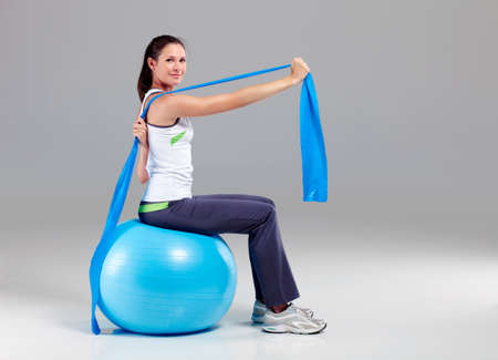 elastic band: Young woman training with elastic band