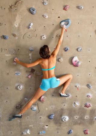 woman handle success: Climbing woman Stock Photo