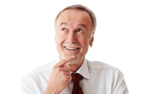 looking up: Senior business man thinking