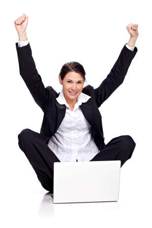 woman sitting with laptop: Young business woman with laptop, jubilant Stock Photo