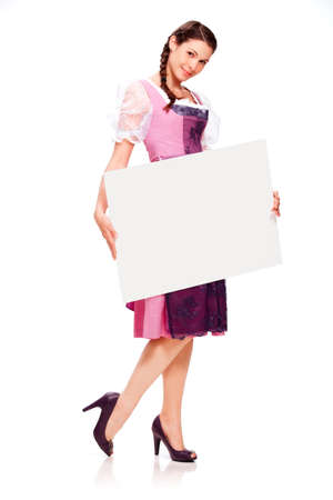 Young woman with dirndl dress and board photo