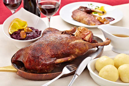 Roasted goose with red cabbage and dumplings 스톡 콘텐츠
