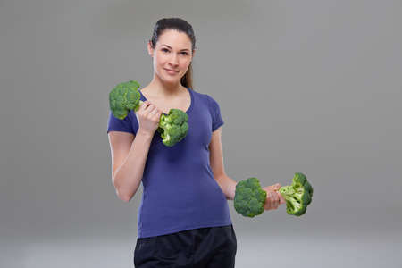 heave: Exercise with broccoli dumbbell symbol